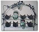 wine rack with leaf and grape designs